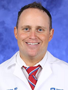A professional head and shoulders photo of Dr. Scott Walen